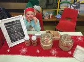 Florence Jones (Reception Class) helping on the reindeer food bar and sporting elf accessories from the 'elf yourself' stall